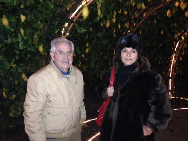 Owner Oscar Tintori and Travel Agent Violetta Buti visiting the citrus garden